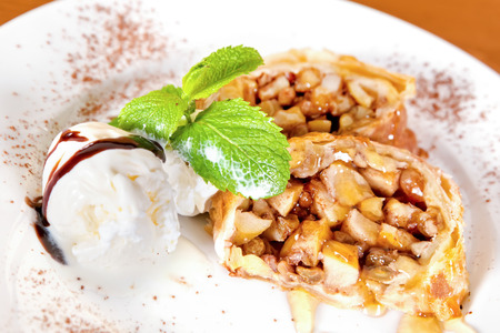 Apple strudel with vanilla ice cream and mint twig