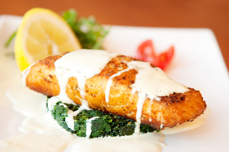 Grilled salmon fillet with spinach and creamy sauce Stok Fotoğraf