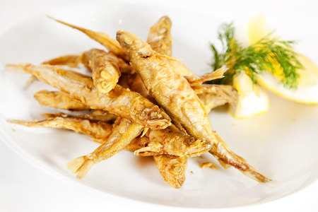Fried smelt fish with lemon and dill Stock Photo