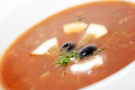 solyanka: Meat solyanka with lemon, olives and greens