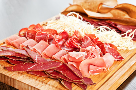 Assorted meat delicatessen with suluguni cheese