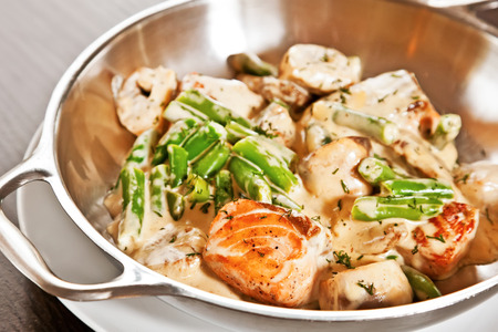 deepsea: Salmon stew with asparagus and deep-sea scallop Stock Photo