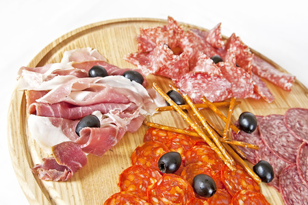 grissini: Assorted meat delicatessen with olives and grissini sticks Stock Photo
