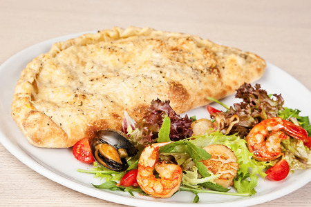 deepsea: Calzone with prawns, mussels, octopus, squids and deep-sea scallop