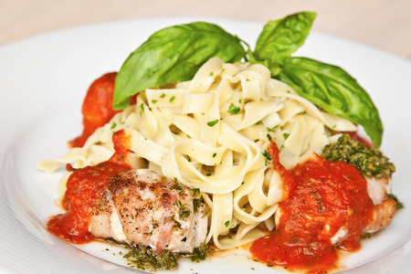 Tagliatelle with veal, vegetable sauce and basil photo
