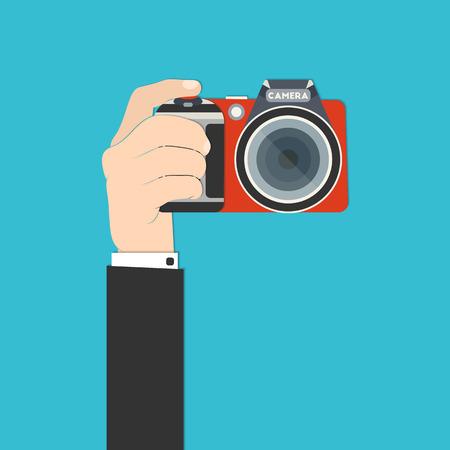Ilustración vectorial de una mano que sostiene la cámara réflex digital para su diseño