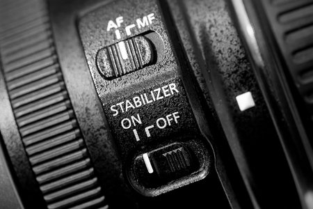 stabilizer: Close up of lens stabilizer. Black and white image of the part of camera lens. Stock Photo