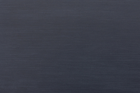 Dark smooth brushed metallic texture as a background