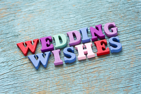 wedding wishes: Wedding wishes phrase made of wooden colorful letters on vintage background