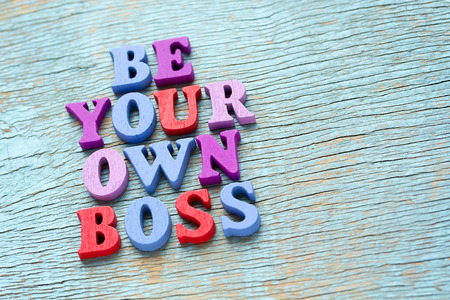 Be your own boss phrase made of wooden colorful letters on vintage background