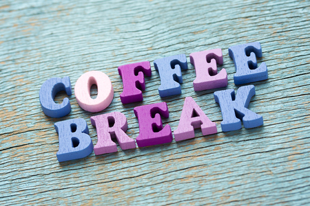 Coffee break phrase made of wooden colorful letters on vintage background