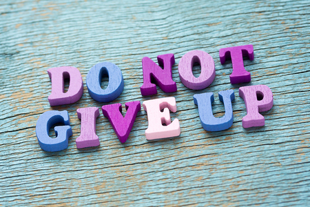 not give: Do not give up phrase made of wooden colorful letters on vintage background