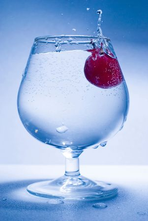 froze: grape fall into glass water, froze motion Stock Photo