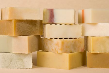 group of handmade soap with herbal material, soap stack.  photo