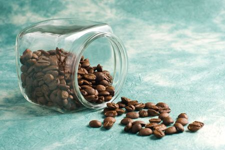Coffee with beans in glass jar on special retro background photo