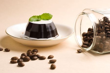 Coffee, coffee pudding and coffee beans in glass jar photo