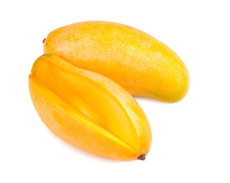 mangoes: delicious mango fruit and slice on white background, tropical fruit. Stock Photo