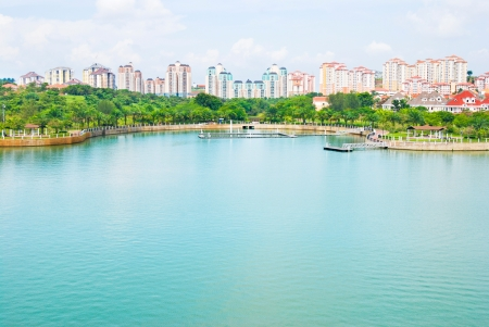 riverside trees: Colorful new buildings and putra Lake, Putrajaya, Malaysia Stock Photo
