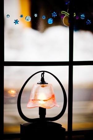 lampshade: little light with glass lampshade decoration near the window Stock Photo