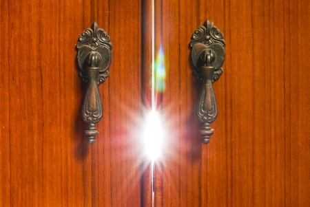 Mystery light from the wooden cabinet. Mystery concept. Stock Photo - 7647554