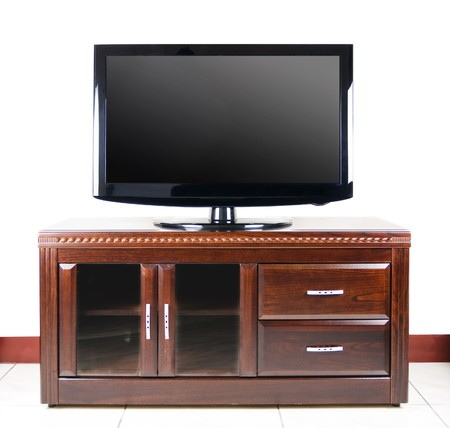 Tv Plasma Kast.Modern Television On Wooden Cabinet In The Living Room Stock Photo