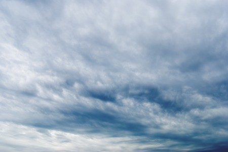 Cloudy sky full of deep grey clouds. Storm is coming. photo