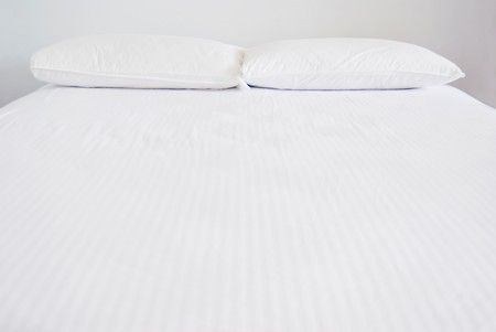 White pillows and bed in white bedroom Stock Photo - 7723017