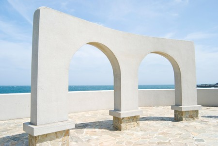 beautiful architecture, arch door decoration in the park near ocean photo