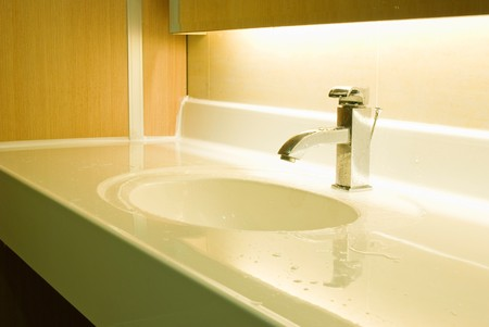 Fresh and vintage washbasin and chrome tap  photo