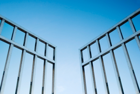 keys to heaven: iron gate open to the sky, concept of freedom