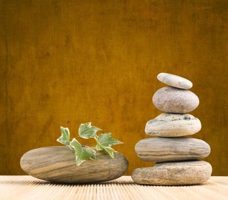 Stack pebbles on bamboo table with grungy background Stock Photo - 7824696