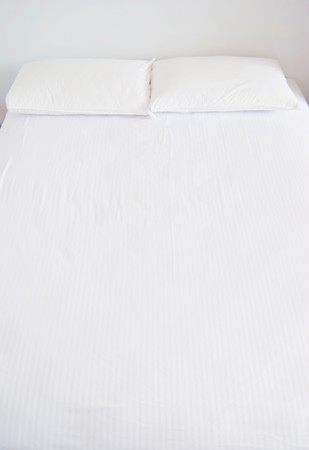 White pillows and bed in white bedroom Stock Photo - 7832521