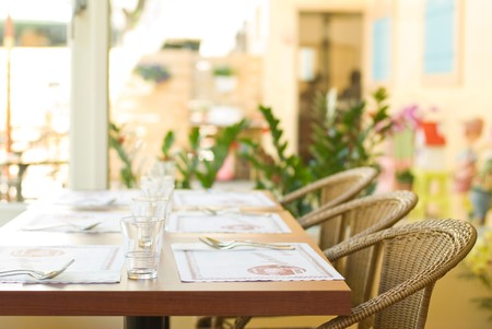 french countryside: Tableware on table with series chairs. Restaurant in countryside  Stock Photo