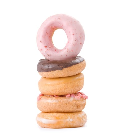 Stack of colorful and delicious donut isolated on white ackground Stock Photo - 7832532