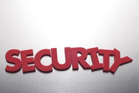 security word on metal background, part of a series of business words photo