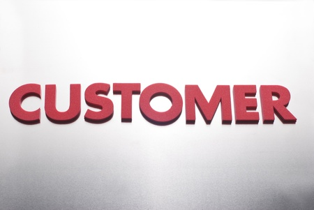 customer word on metal background, part of a series of business words photo