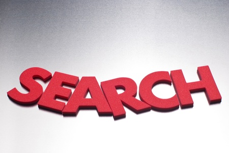 search word on metal background, part of a series of business words Stock Photo - 8367380