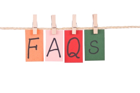faq's: FAQS, Colorful words hang on rope by wooden peg