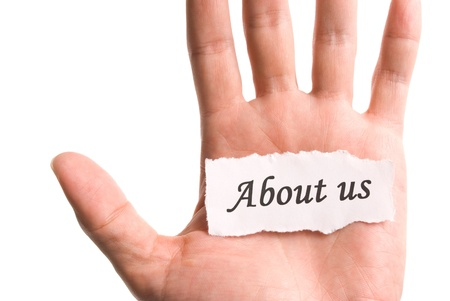 About us, word in hand, word on piece tear paper Stock Photo - 8367403