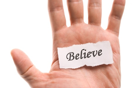 Believe word in hand, word on piece tear paper Stock Photo - 8367407