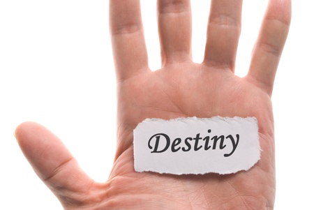 Destiny word in hand, word on piece tear paper photo