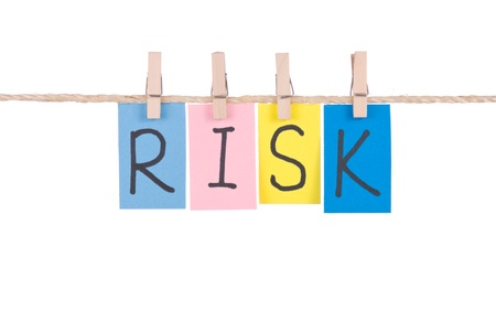 Risk, Colorful words hang on rope by wooden peg photo