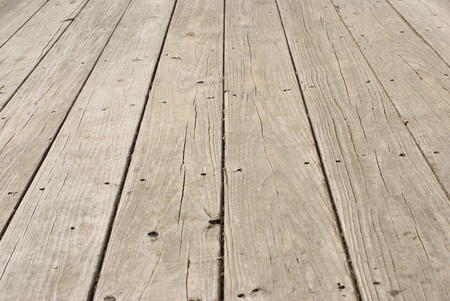 Grunge wooden floor with old nails in it photo