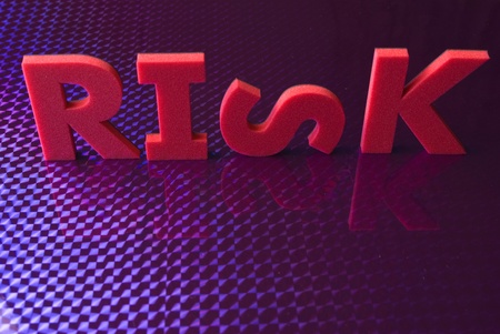 risk word on blue neon background, part of a series of business words Stock Photo - 8428260