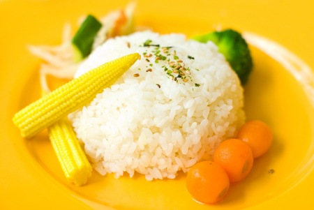 Chinese food, Rice, sweet corn and red radish in dish. photo