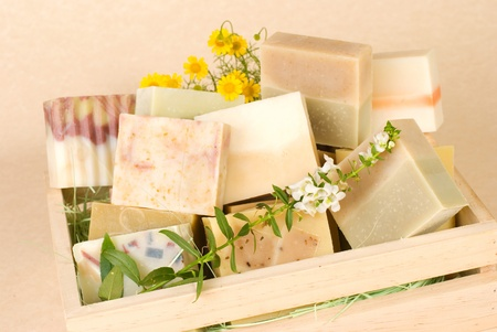 group of handmade soap in wooden box, nature material. photo