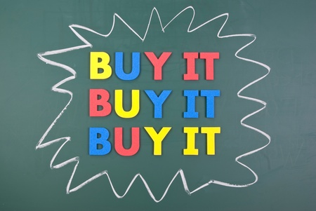 Buy it, colorful words on blackboard, marketing concept photo