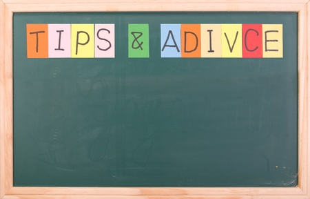 Tips and advice, colorful word on blank blackboard photo