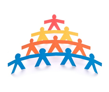 cooperating: Concept of teamwork, colorful paper dolls on white background  Stock Photo