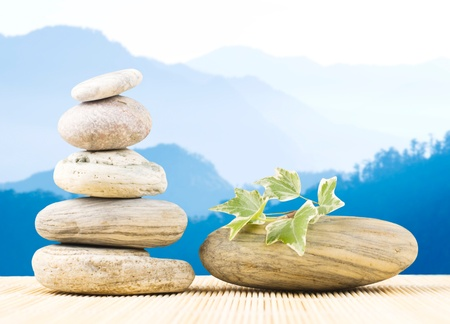 Stack pebbles and mountains with light morning fog. Zen concept. photo